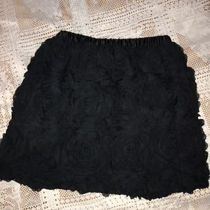 Black skirt with tufted roses